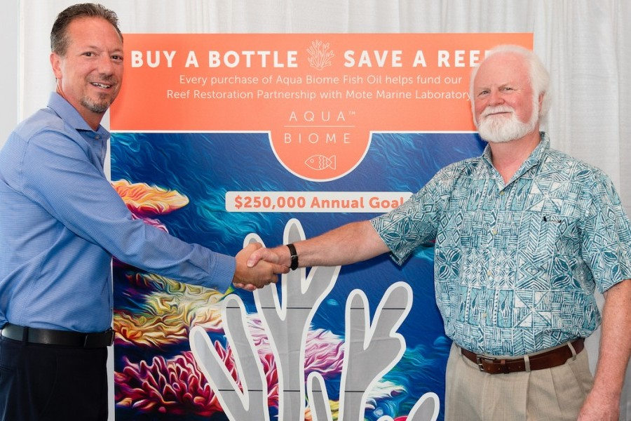 Scott Sensenbrenner, Enzymedica, and Dr. Michael P. Crosby, Mote, celebrate Enzymedica's support of Mote's coral restoration