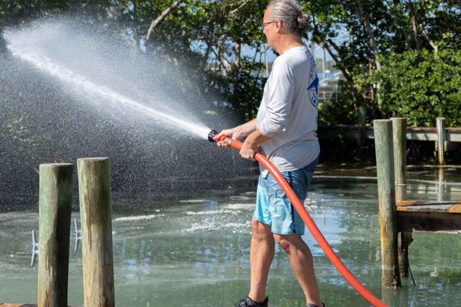 Mote's Dr. Vince Lovko applies clay to a canal with red tide