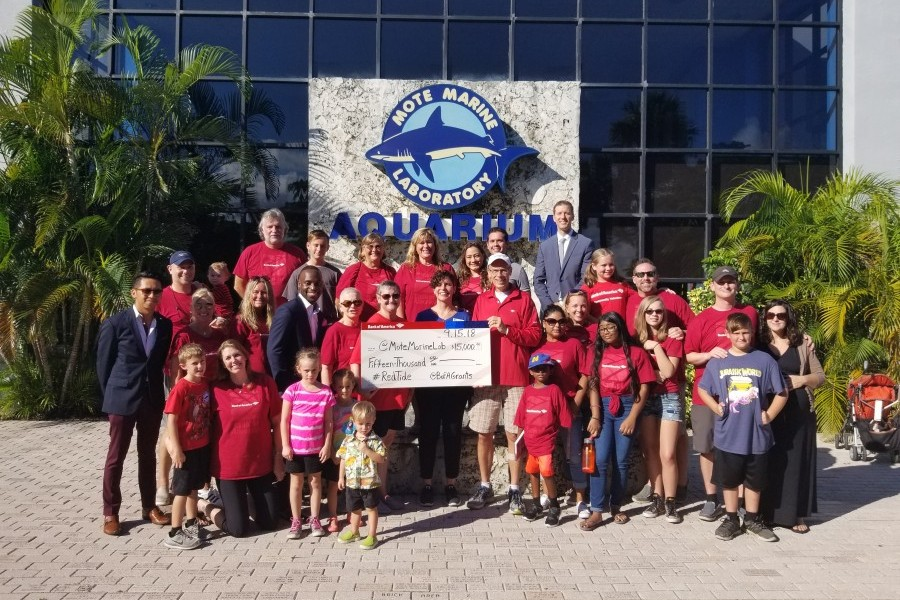 Bank of America staff and family present a $15,000 grant for red tide research to Mote. Credit: Jamie Kahns/Bank of America
