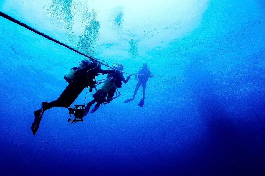 Mote scientists during a dive at the Captiva blue hole