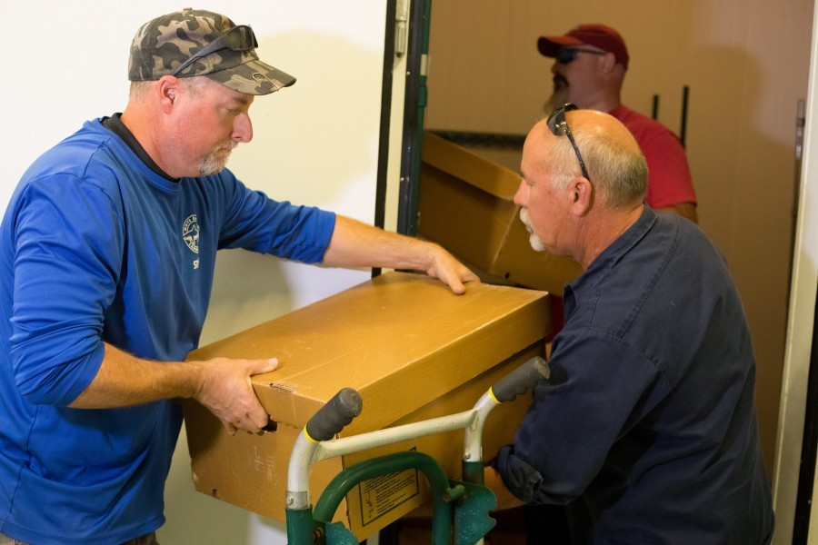 Mote Senior Biologist Tom Waldrop & Steve Duncan, truck driver for Chiles Restaurant Group, move mullet for Mote study.