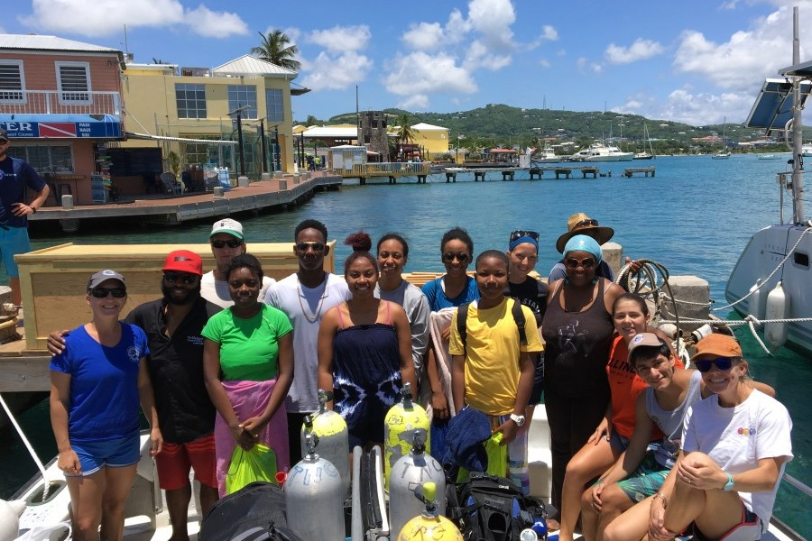 Mote and TNC staff and students from St. Croix smile during their day of coral restoration. Credit Mote Marine Laboratory.