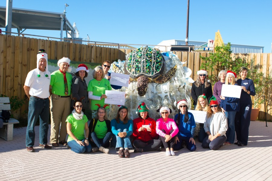 Longboat Key Turtle Watch (LBKTW) volunteers and Mote staff pose at check presentation