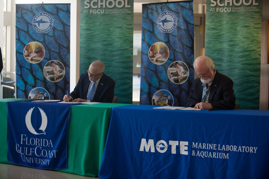 Dr. James Llorens, FGCU Provost, and Dr. Michael Crosby, Mote President & CEO, sign an MOU on April 4. Photo Conor Goulding Mote