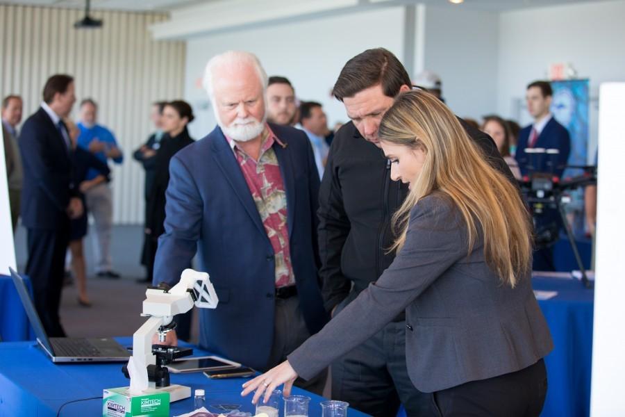 L-R: Mote President & CEO Dr. Michael P. Crosby, Governor DeSantis, & Mote's Dr. Tracy Fanara. Credit: Conor Goulding/Mote