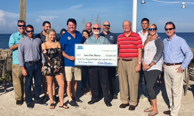 Mote President & CEO accepted the check from the Save Our Shores Long Table Dinner
