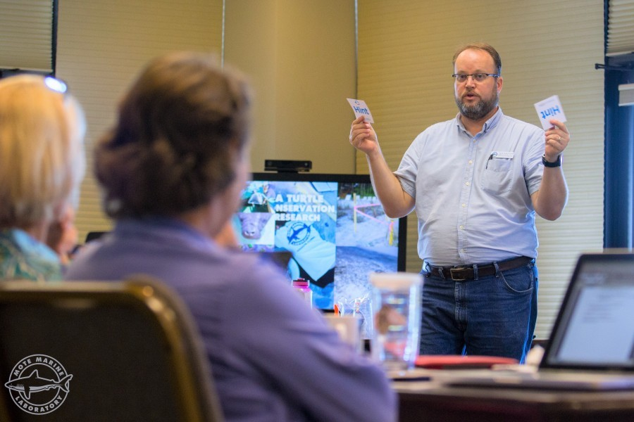 Photo: Jason Robertshaw educates adults about marine science. Credit: Conor Goulding/Mote Marine Laboratory