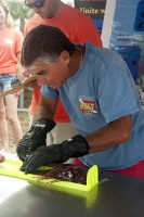 Lad Akins of Reef Environment Education Foundation (REEF) measures a lionfish caught during the second annual Sarasota Lionfish Derby.