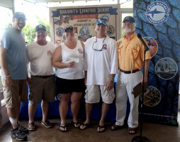 "Team ""We Be Dreamin'/Jim's Dive Shop"" caught the most lionfish and largest lionfish.  L-R: Allie Elhage of ZooKeeper with team We Be Dreamin'/Jim's Dive Shop members Mike Dreamer, Kristie Gilford and Bob Richardson, and Mote CEO Dr. Michael P. Crosby"