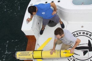 "Mote engineering technician Michael Tamez and Mote postdoctoral scientist Dr. Jordon Beckler prepare to launch AUV ""Genie"" for a test at sea on Oct. 28."
