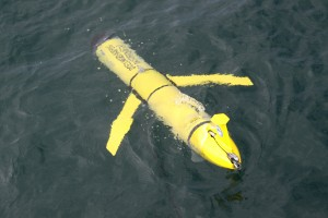 "The AUV ""Genie"" is in the ocean during its test run on Oct. 28, in preparation for the AUV's first real mission at sea in November 2015."