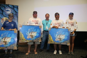 The team who caught the most lionfish, Humpty Dumpty, receives their awards at the fifth annual Sarasota Lionfish Derby. From left: Mote's Membership & Special Events Coordinator Sam Byrd, team member Josh Taylor, David Ventura of Whole Foods, team m