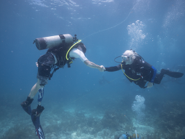 Mote President & CEO Dr. Michael P. Crosby shakes hands underwater with Billy Costello, retired Sgt. 1st Class, U.S. Army, after a mission well done on Monday, July 20, 2015. Photo credit: Joe Berg/WayDownVideo