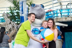 The Paulovski family takes a photo with Mote Marine Laboratory & Aquarium's mascot, Gilly the Shark at the 2017 World Oceans Day celebration.